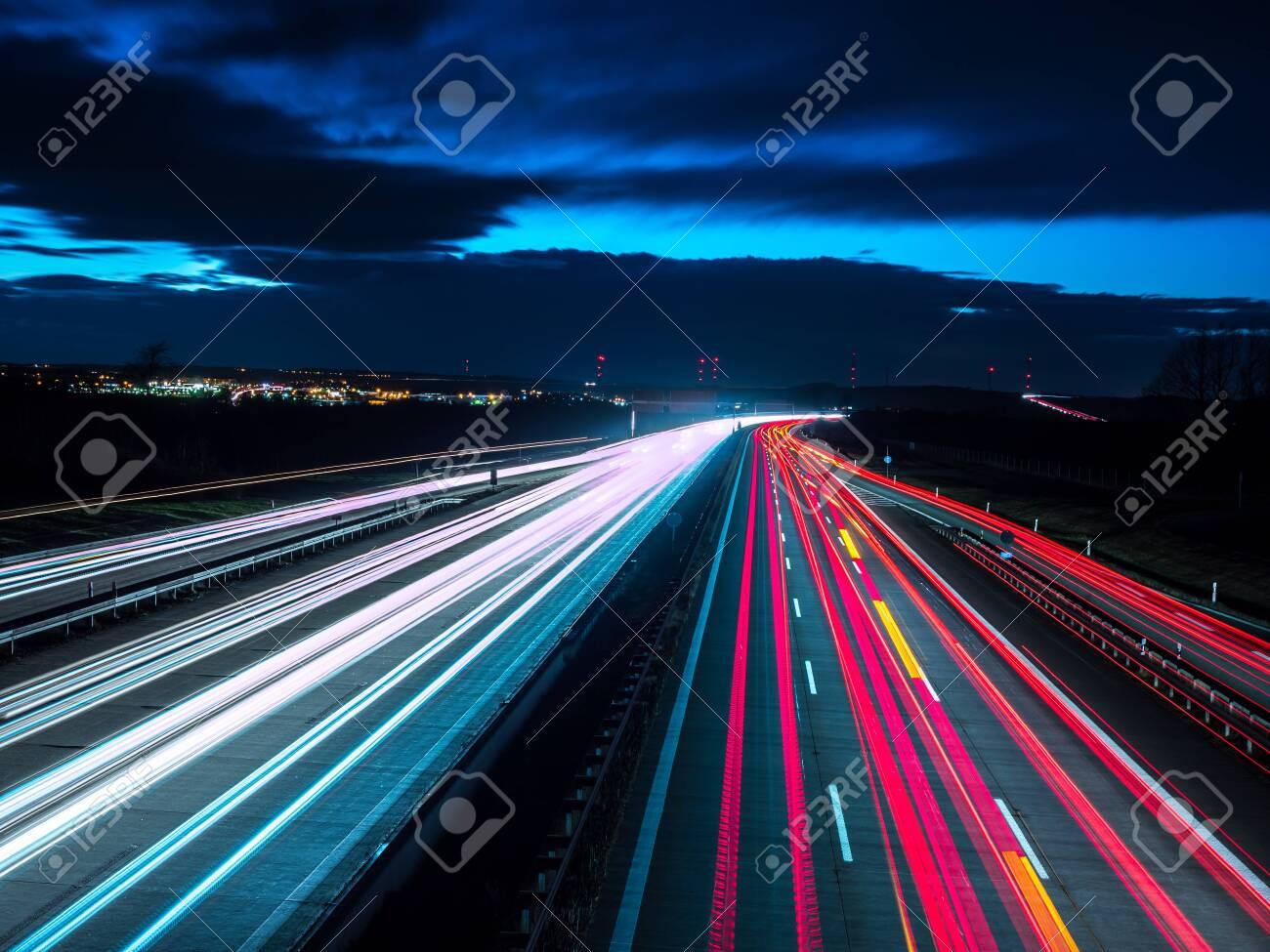 Night traffic on highway - 137792663