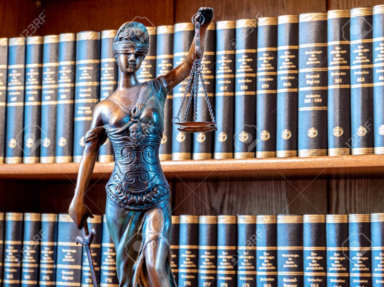 Law Figure Justice Statue In Lawyer's Office With Bookshelf Stock Photo,  Picture And Royalty Free Image. Image 133929814.