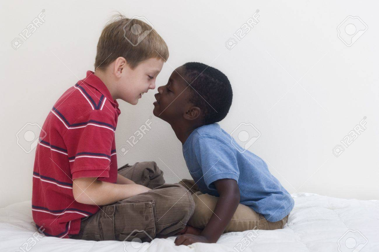 Two young boys of different races playing together. Stock Photo - 536565