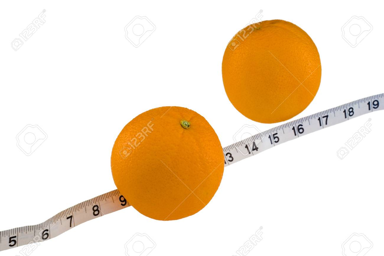 Fresh oranges with a measuing tape on a white background - a delicious and nutritious snack. Stock Photo - 809201