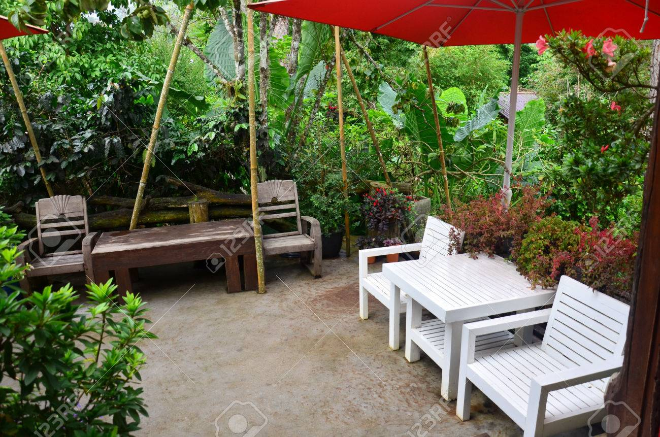 decorative furniture in the garden at outdoor of coffee shop stock