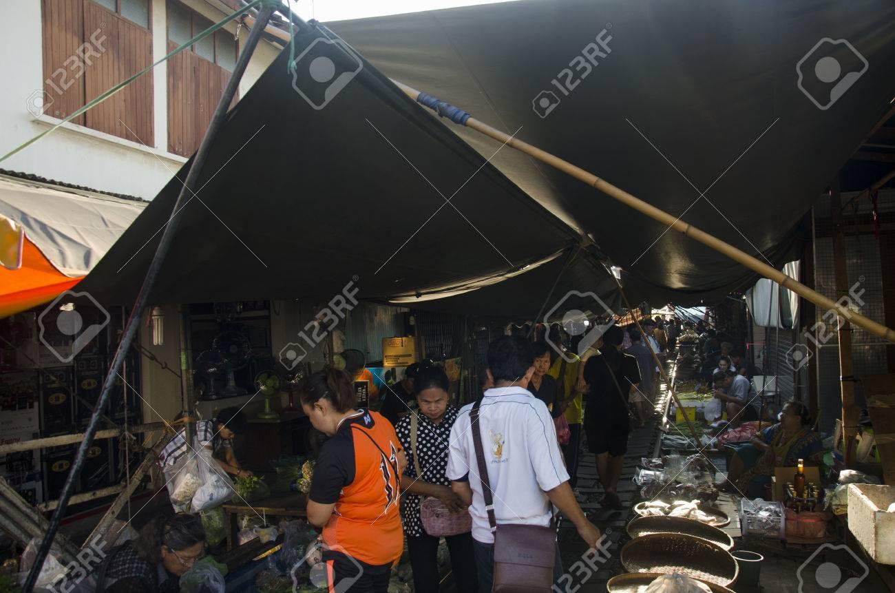People walking visit and shopping in Mae klong Railway Market