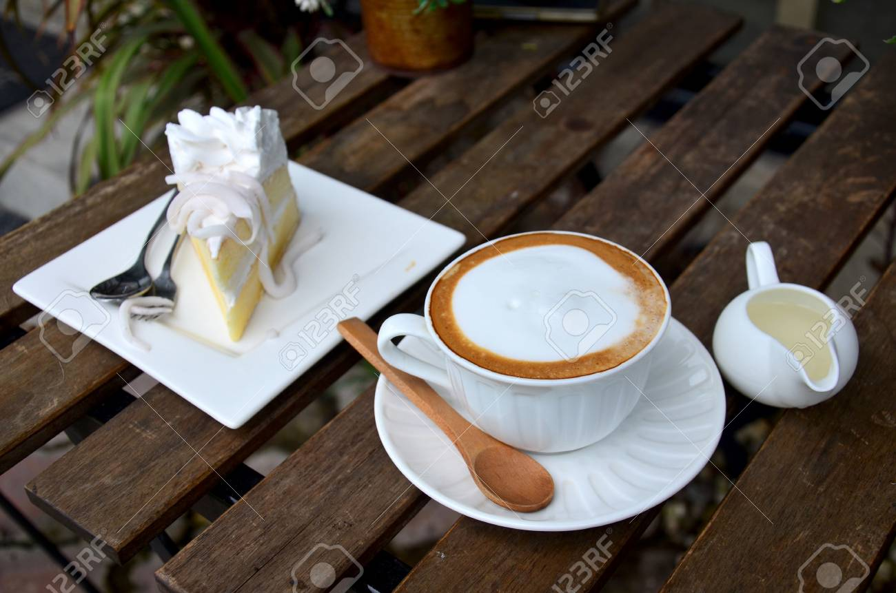 Latte Hot Coffee And Coconut Cake On Table In Garden Of Coffee Stock Photo Picture And Royalty Free Image Image 81383001