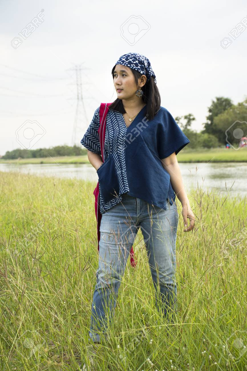 Asian thai woman wearing fashion indigo clothes posing portrait for take  photo at outdoor in countryside