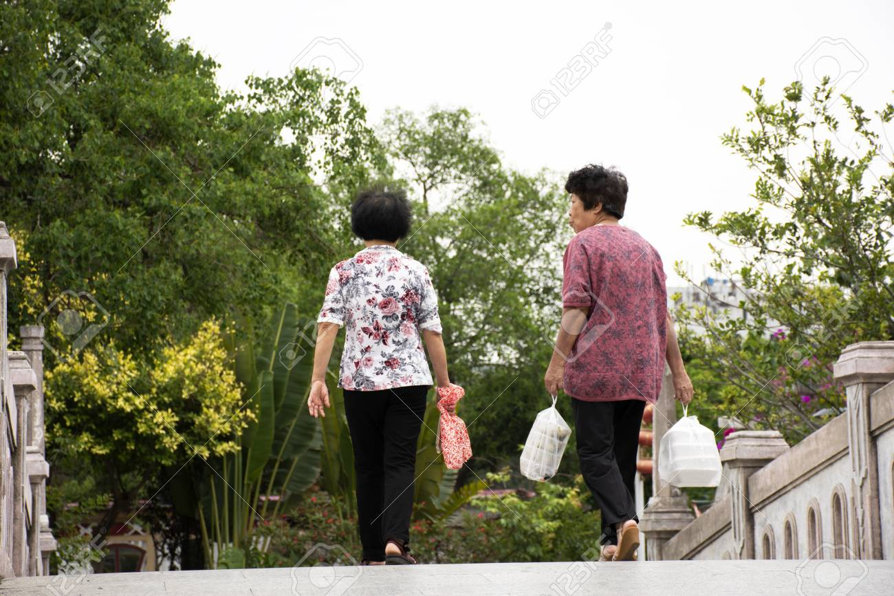 Chinese Old Women People Walking Holding Food In Plastic Bag