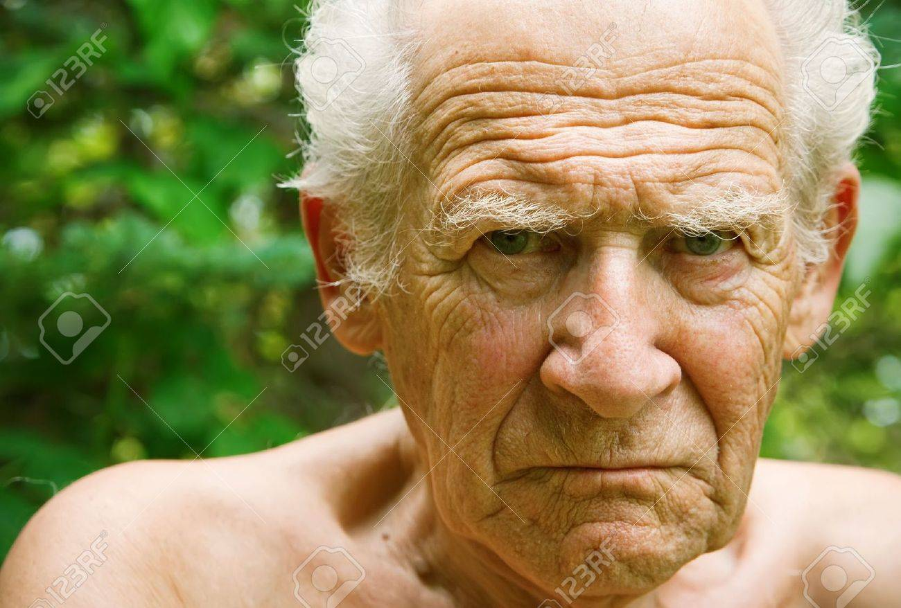 face portrait of an old angry frowning senior man - 7873939