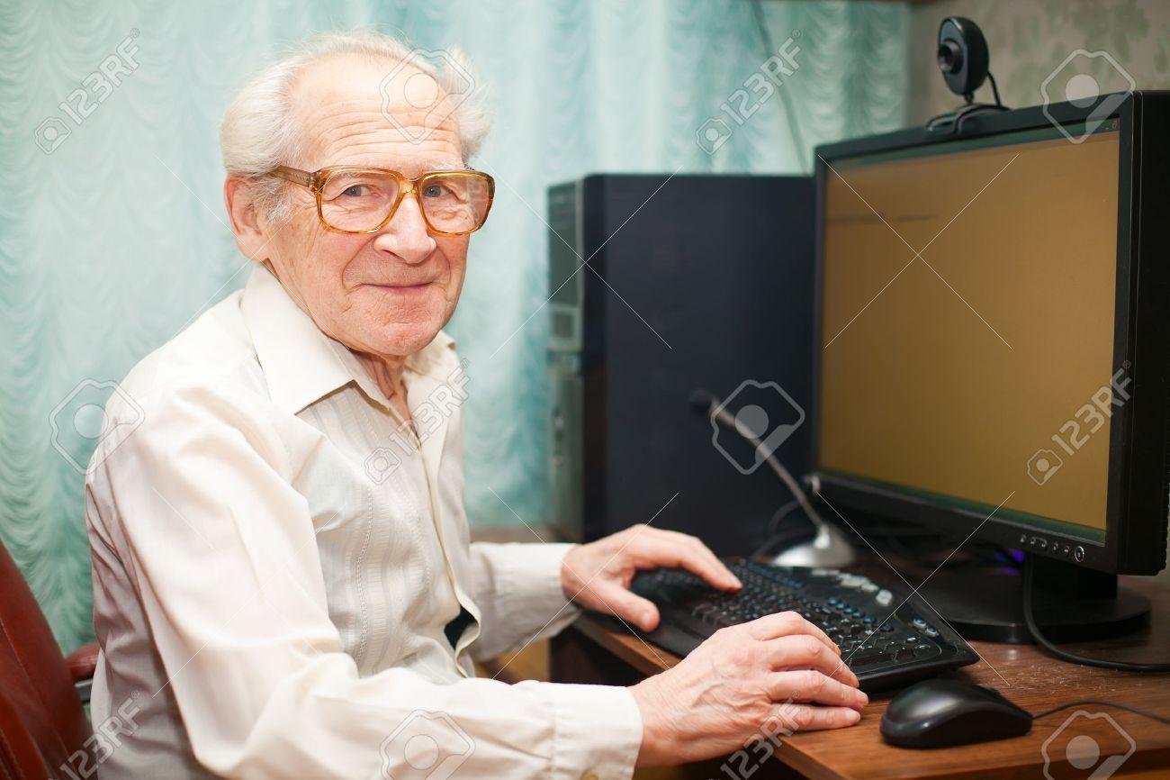 14170943-smiling-happy-old-man-sitting-n