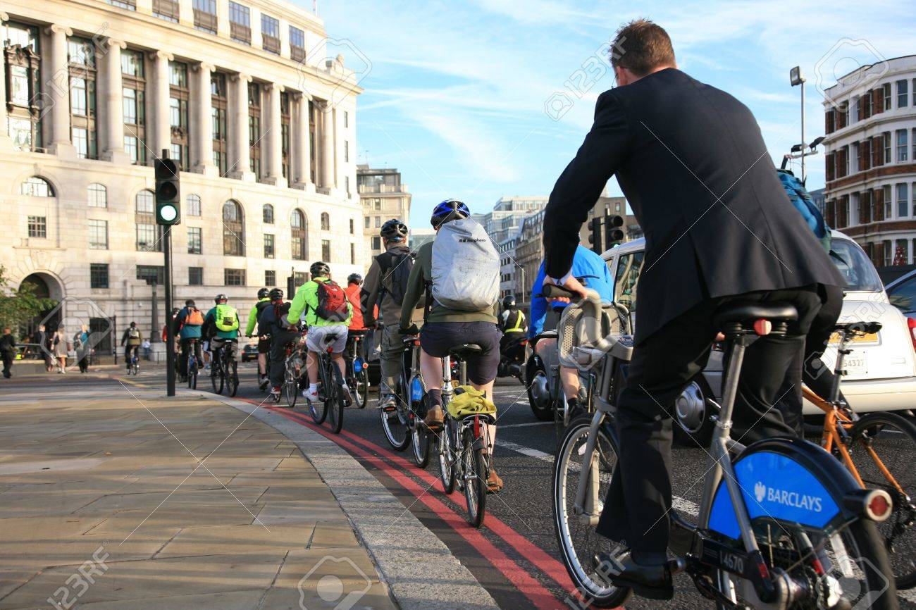 London, UK - October 2, 2010 - Bicycle commuters on their way to work after crossing Blackfriars bridge in early morning. - 10052078
