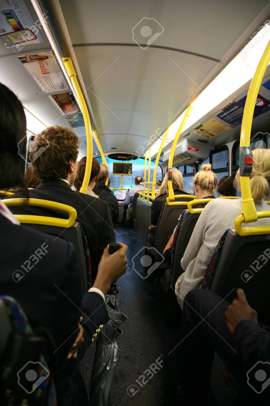 London, UK - August 25, 2010: Interior of London Dobule Decker Bus, passengers are seating on upper deck on the way to work.  Stock Photo - 10404617