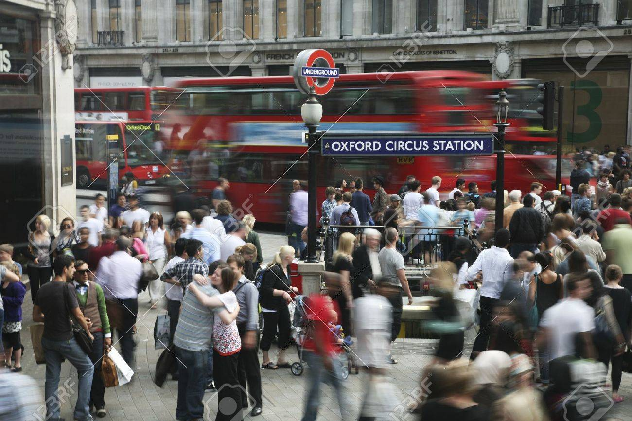 London, UK - August 02, 2010: Crowds passing oxford circus station. Oxford street is one of the most busy shopping streets in the world. Stock Photo - 10581348