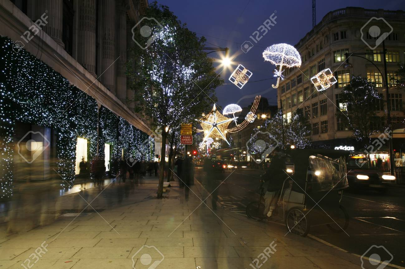 London, UK - November 15, 2011: Street Night View of Oxford Street with Christmas Decoration. Oxford Street is one of the most famous shopping street in London. Stock Photo - 11215554