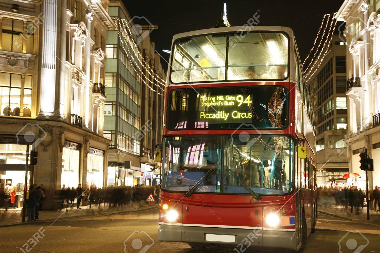 Double Decker Bus, most iconic symbol of London, in Oxford Street at Night.  Stock Photo - 11249553