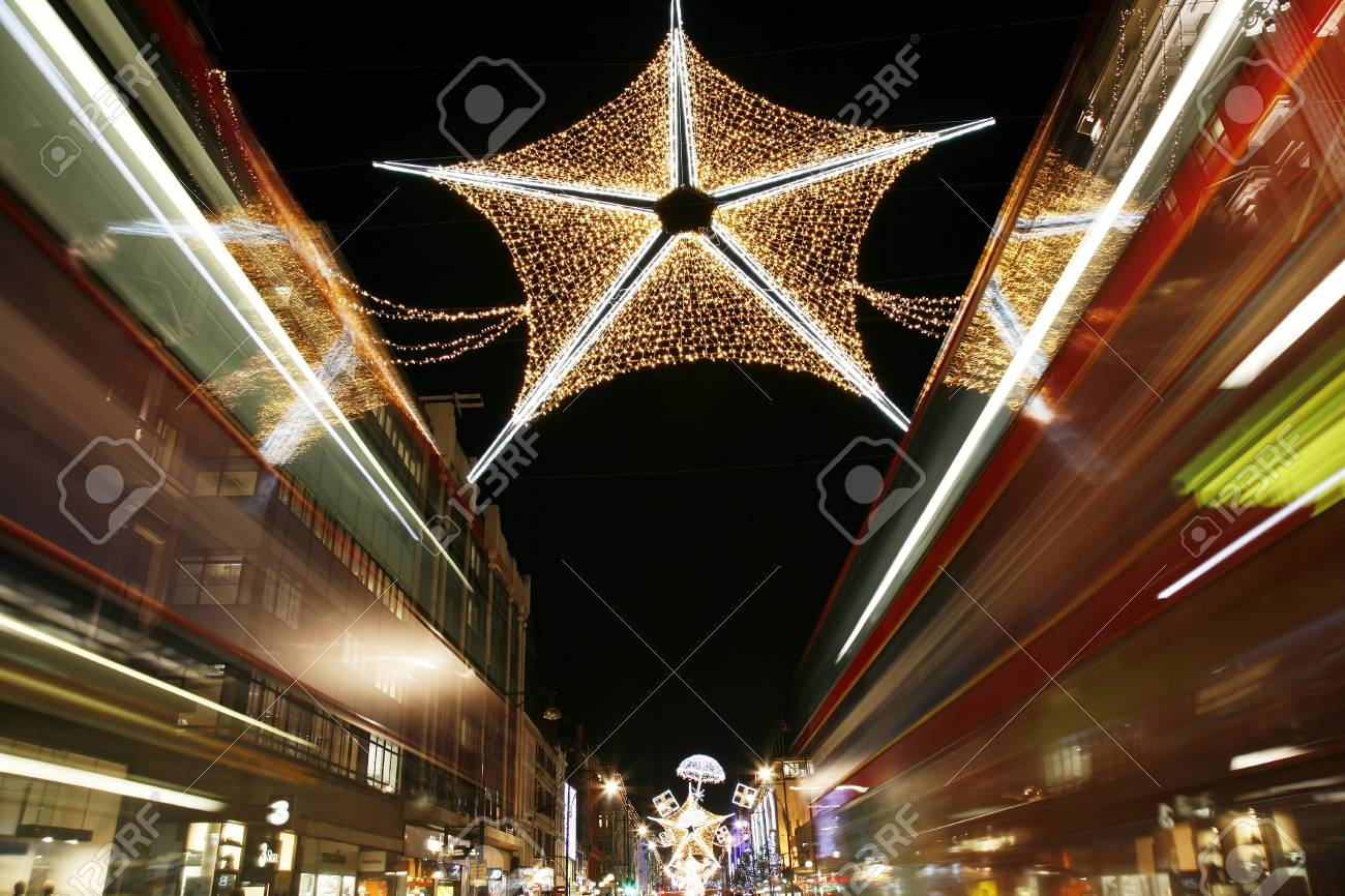 London, UK - November 17, 2011: Christmas Lights Display on Oxford Street in London. The modern colourful Christmas lights attract and encourage people to the street.  Stock Photo - 11240985