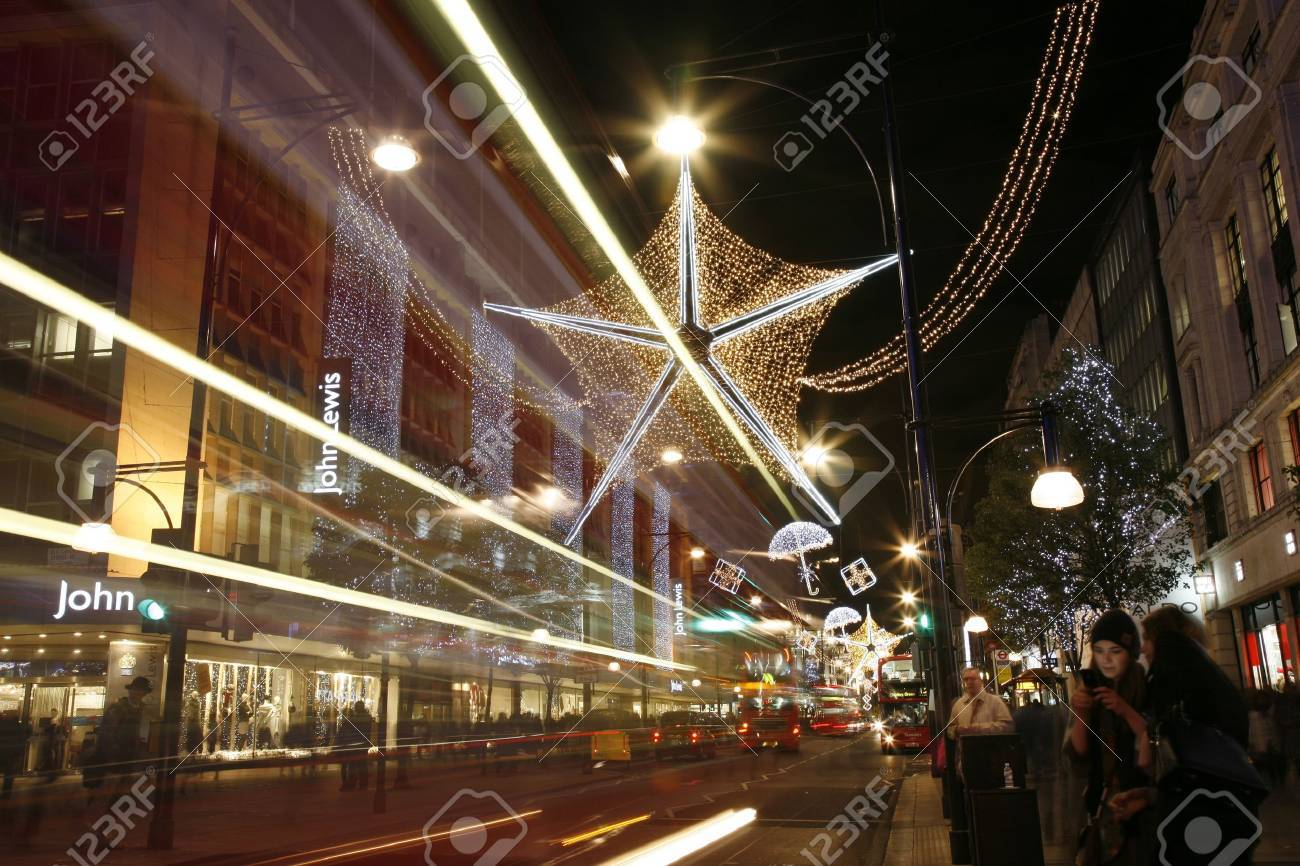 London, UK - November 18, 2011: Christmas Lights Display on Oxford Street in London. The modern colourful Christmas lights attract and encourage people to the street.  Stock Photo - 11260262