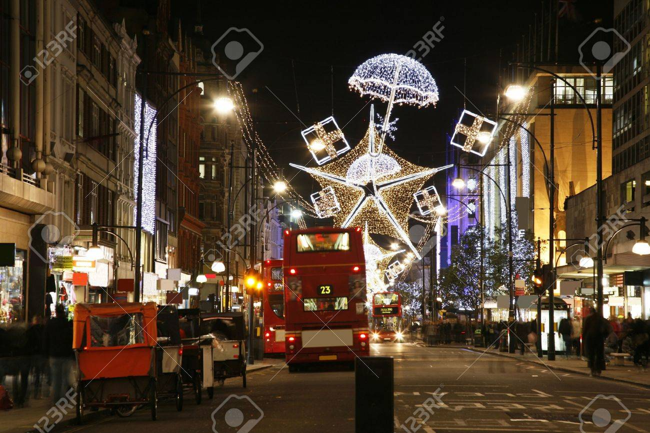 Christmas Lights Display on Oxford Street in London. The modern colourful Christmas lights attract and encourage people to the street.  Stock Photo - 11691978