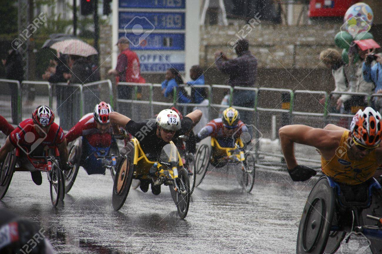 London, UK - April 25, 2010: Wheelchair racing contestants in the London Marathon. The London Marathon is next to New York, Berlin, Chicago and Boston to the World Marathon Majors, the Champions League in the marathon.    Stock Photo - 11581384