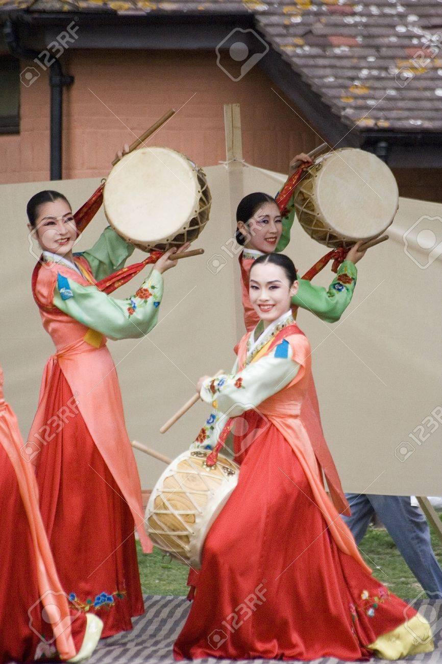 London, UK - August 15, 2009: Korean ethnic dancers perform, Jindo Bukchum, drum dance, in the Korean Festival on August 15, 2009 in London, UK.   Stock Photo - 11653794