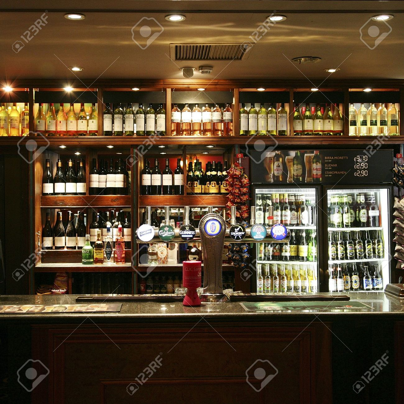 London, UK - June 03, 2011: Inside view of a public house, known as pub, for drinking and socializing, is the focal point of the community, Pub business, now about 53,500 pubs in the UK, has been declining every year.   Stock Photo - 12468959