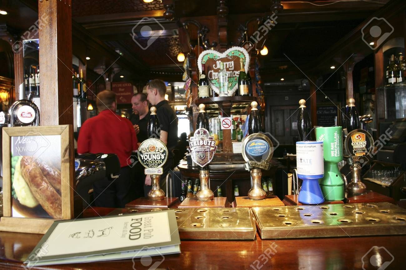 London, UK - August 30, 2010: Inside view of a public house, known as pub, for drinking and socializing, is the focal point of the community, Pub business, now about 53,500 pubs in the UK, has been declining every year.    Stock Photo - 12468963