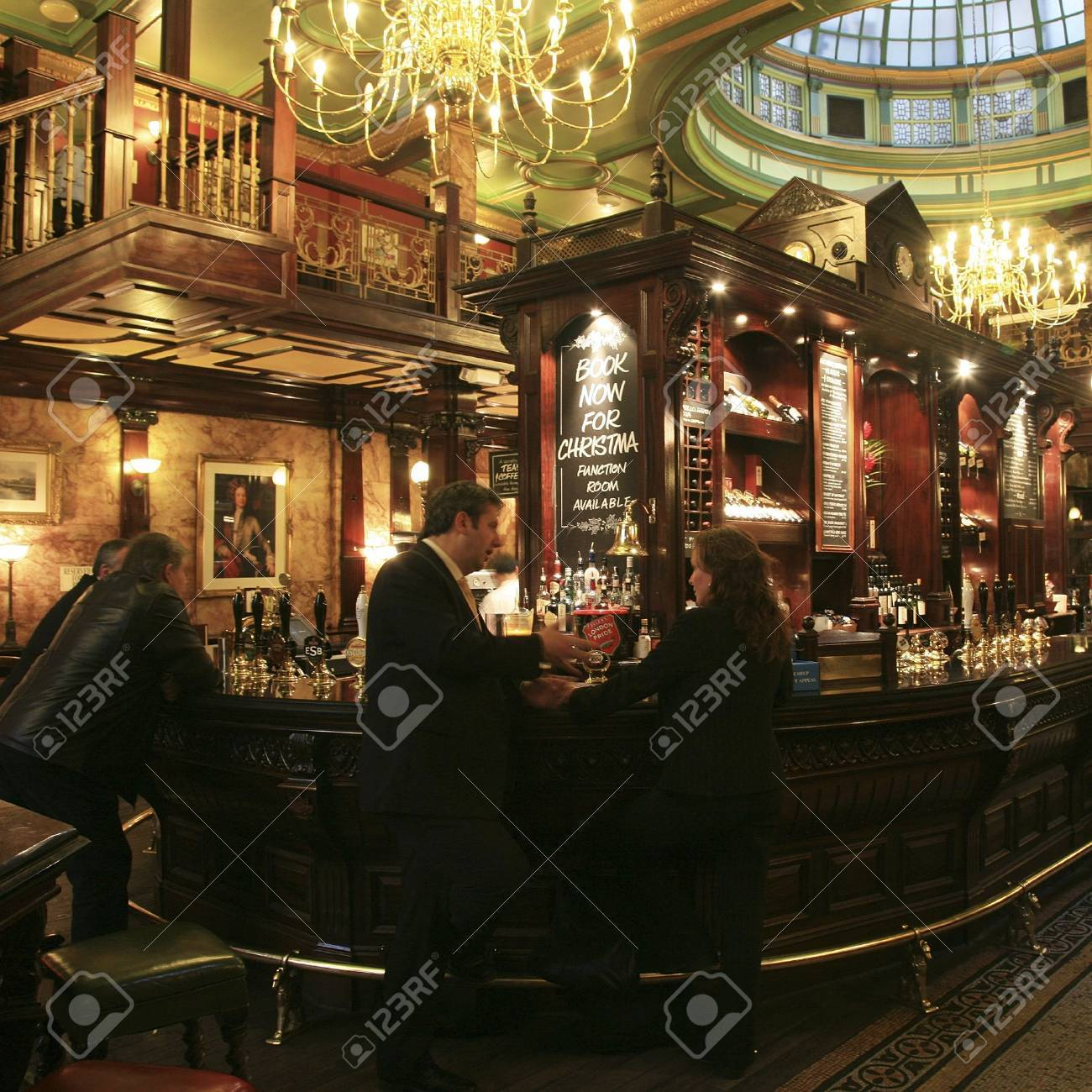 London, UK - November 04, 2010: Inside view of a public house, known as pub, for drinking and socializing, is the focal point of the community, Pub business, now about 53,500 pubs in the UK, has been declining every year.   Stock Photo - 12468953