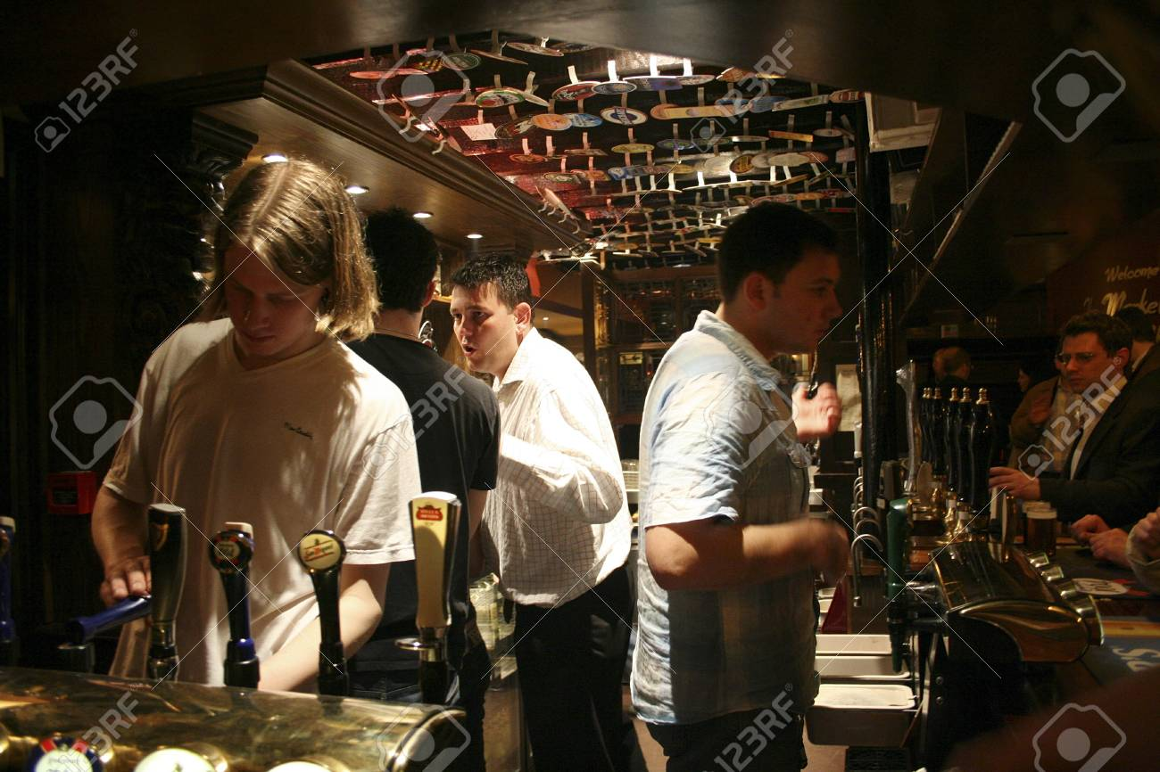 London, UK - April 13, 2006: Inside view of a public house, known as pub, for drinking and socializing, is the focal point of the community, Pub business, now about 53,500 pubs in the UK, has been declining every year.  Stock Photo - 12716846