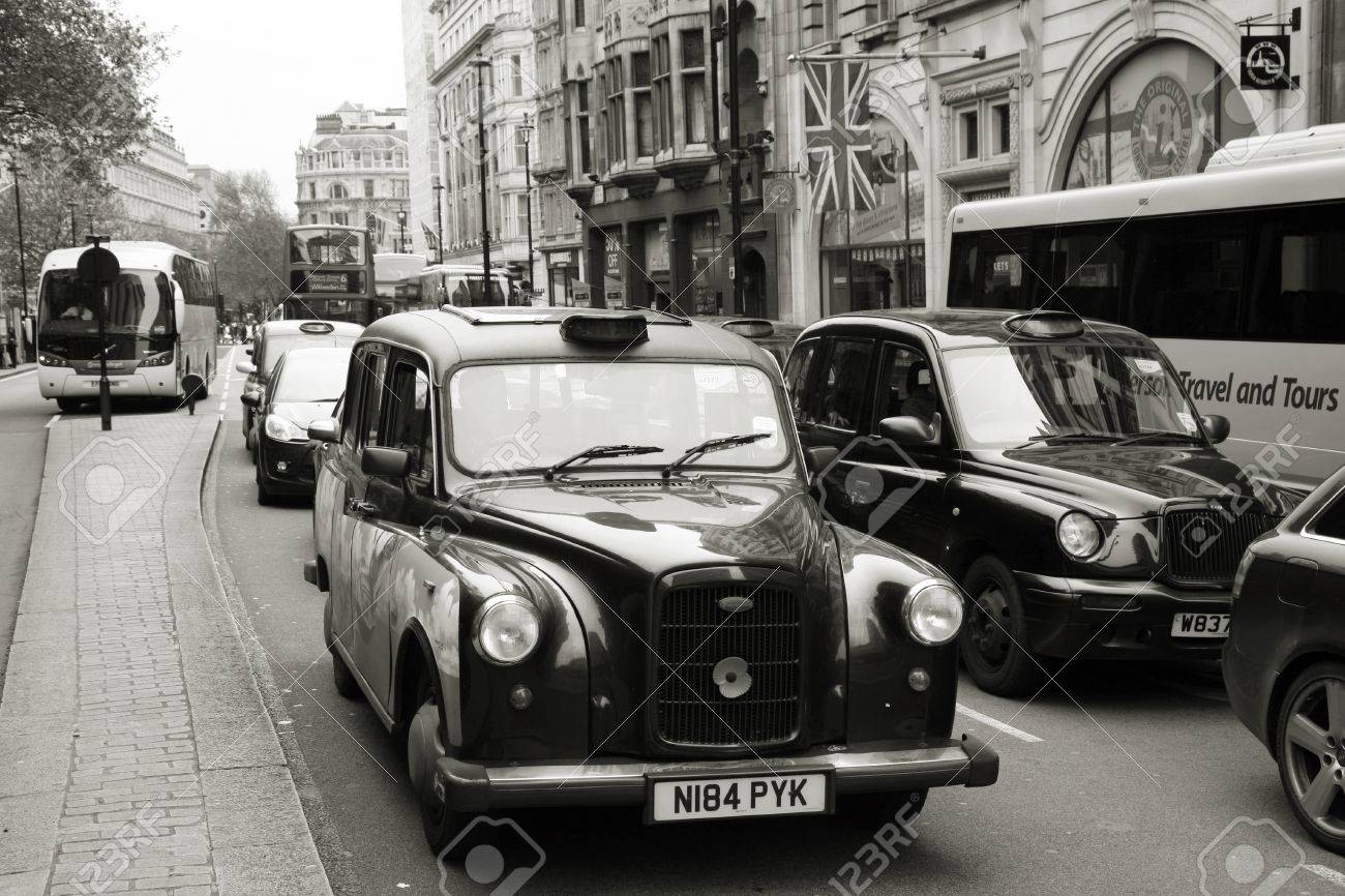 London, UK - May 6, 2012: FX4, London Taxi, also called hackney carriage, black cab. Traditionally Taxi cabs are all black in London but now produced in various colors. Stock Photo - 15547579