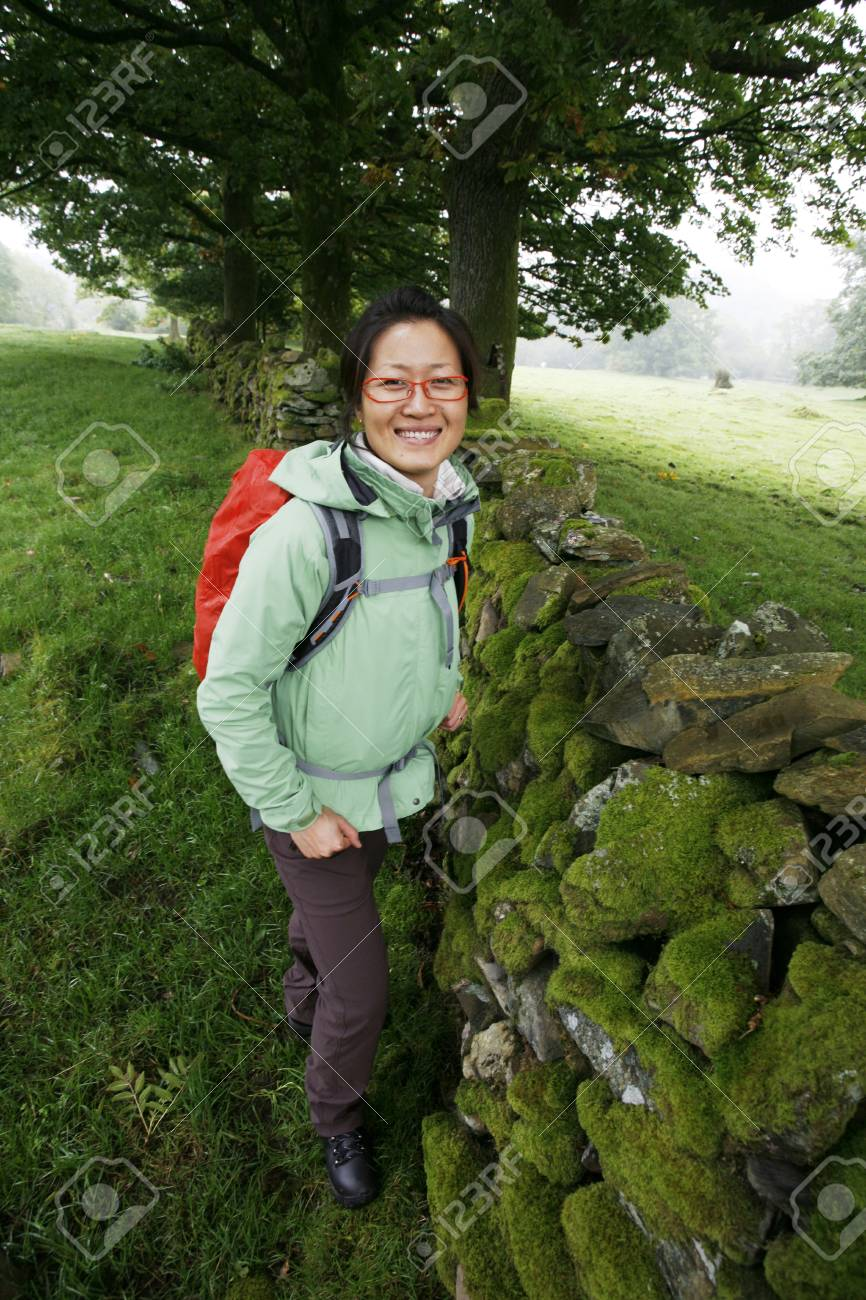Smiling East Asian Woman hiking in Lake District, Cumbria, UK. Stock Photo - 24054118