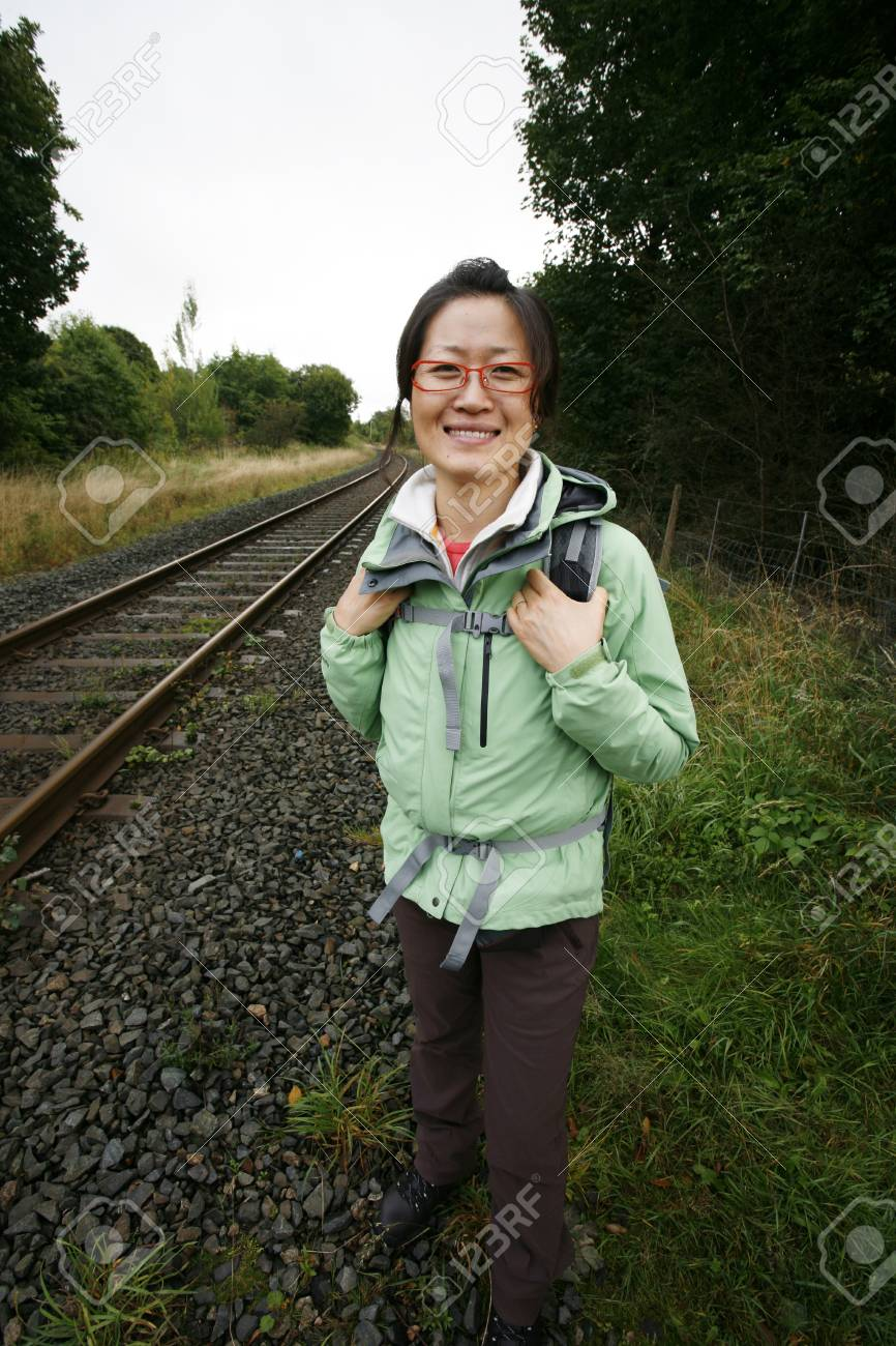 Smiling East Asian Woman hiking in Lake District, Cumbria, UK. Stock Photo - 24054119