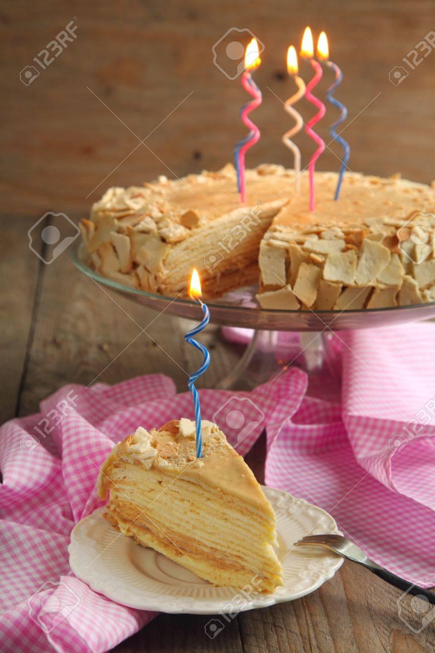 Cake Napoleon Of Puff Pastry With Cream For Birthday Stock Photo