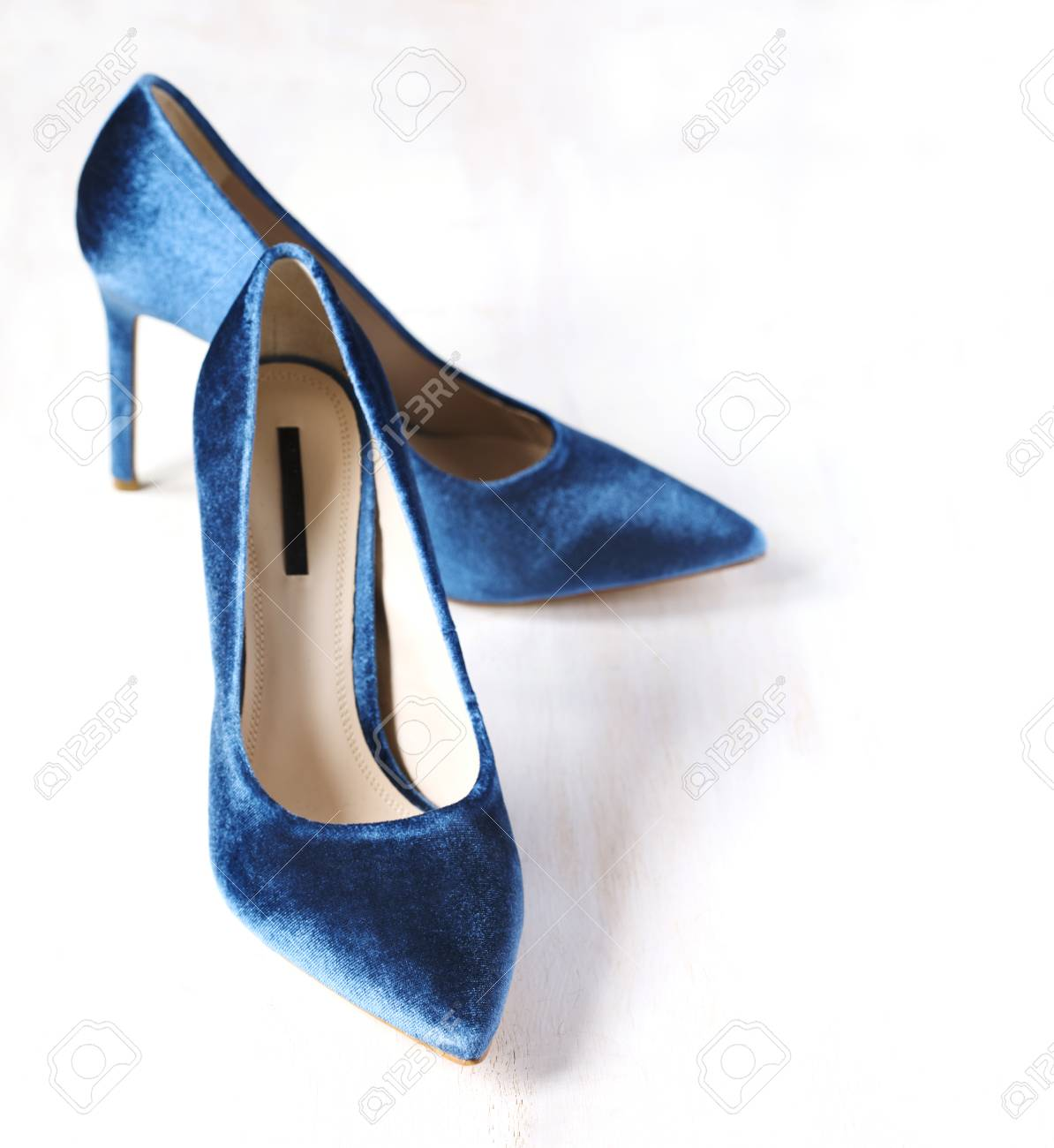8baef2283a Stock Photo - Velvet blue women high heel shoes. Velvet pumps