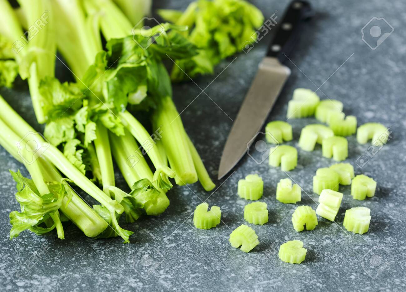Fresh celery on stone background. - 125960514