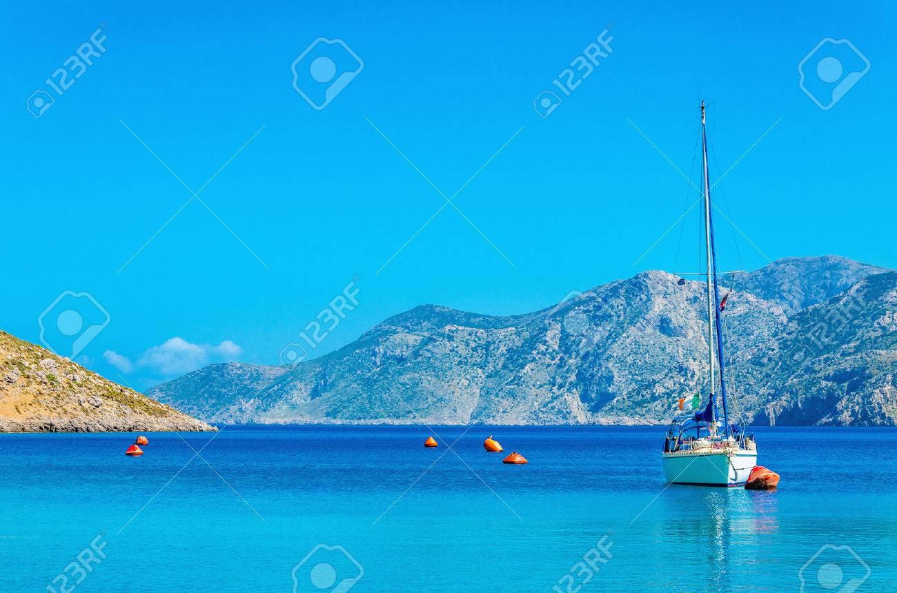 Sport yacht on anchor in silent bay on Greek Island, Greece Stock Photo - 39969757