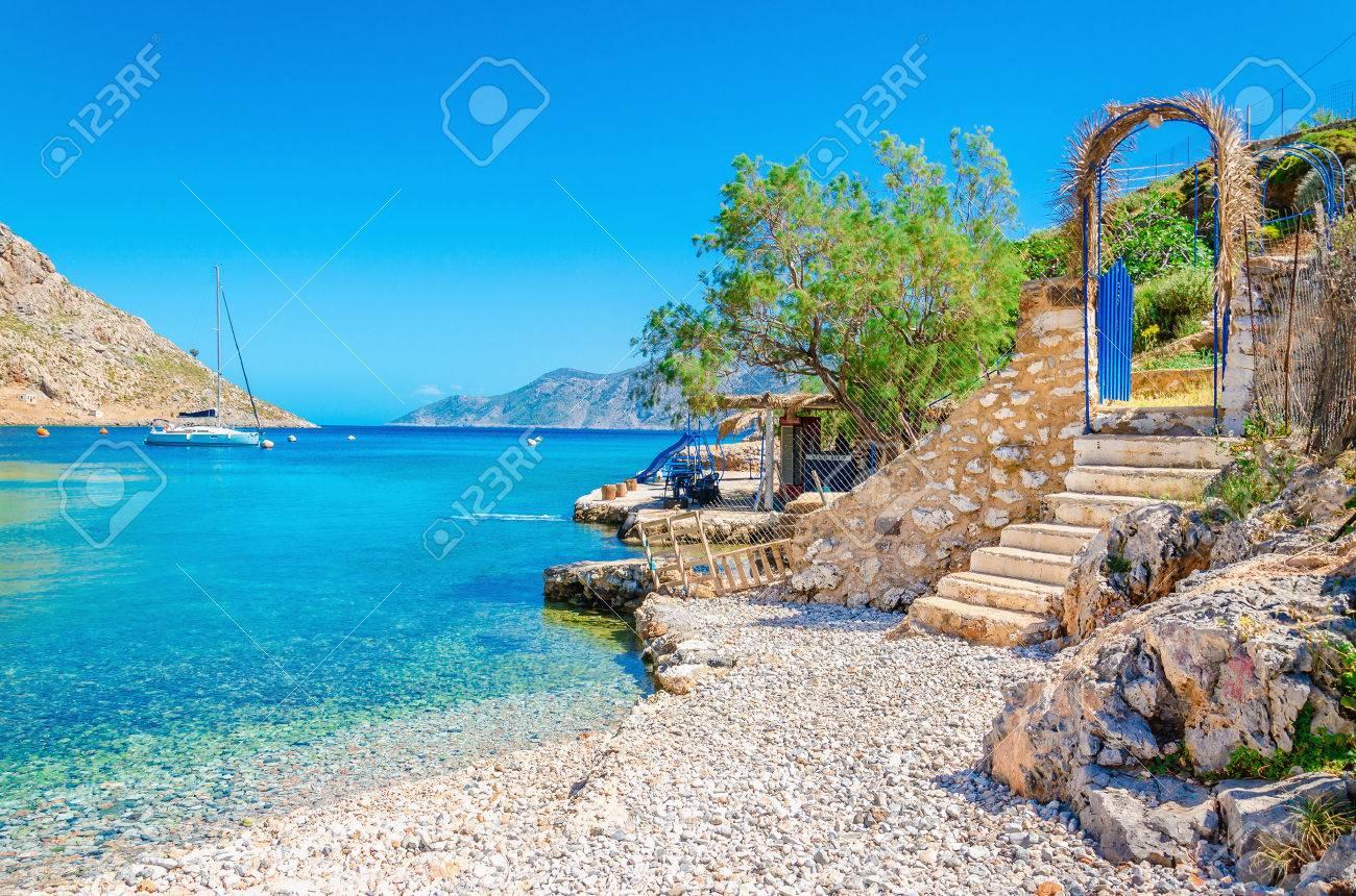 Stairs from sandy beach of amazing bay on Greece island Kalymnos, Greece Stock Photo - 39970583