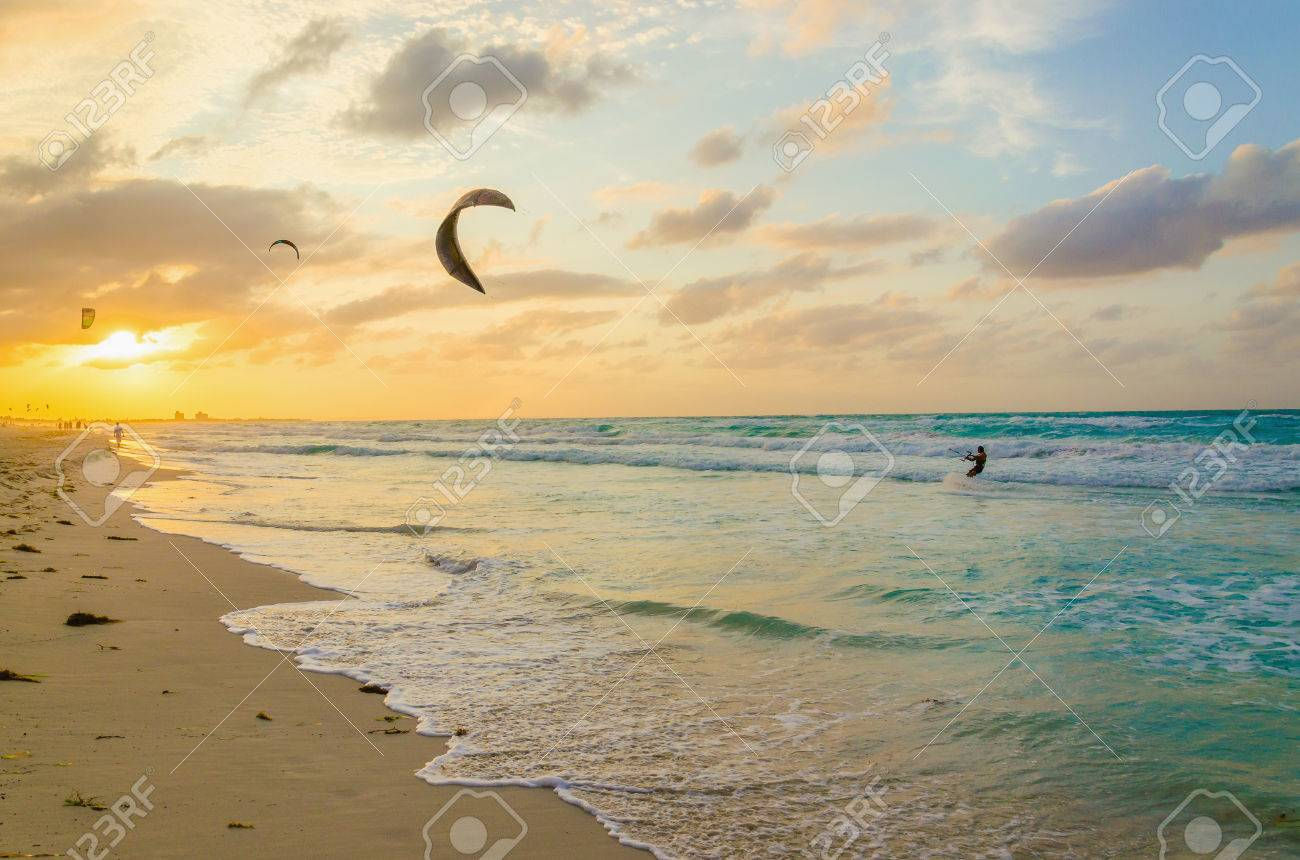 Professional kiter makes the difficult trick on a beautiful background of spray and beautiful sunset Stock Photo - 40181255
