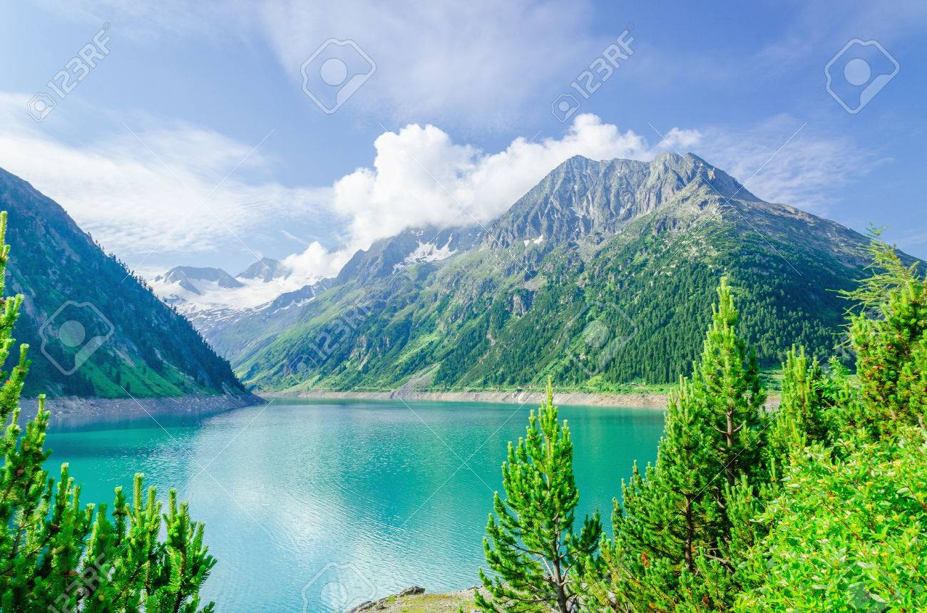 Azure mountain lake on the background of the high peaks of the Alps, Zillertal, Austria Stock Photo - 40182058