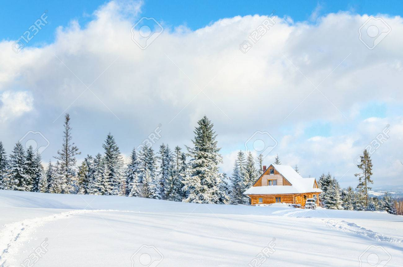 Wooden house with road under the snow and single foot marks only Stock Photo - 40317912