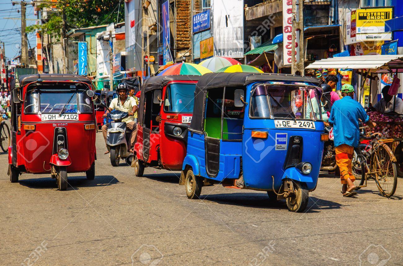 SRI LANKA, COLOMBO - JANUARY 9, 2015: Tuk tuk Sri Lankan traditional taxi in one of the street of Colombo Stock Photo - 40485732