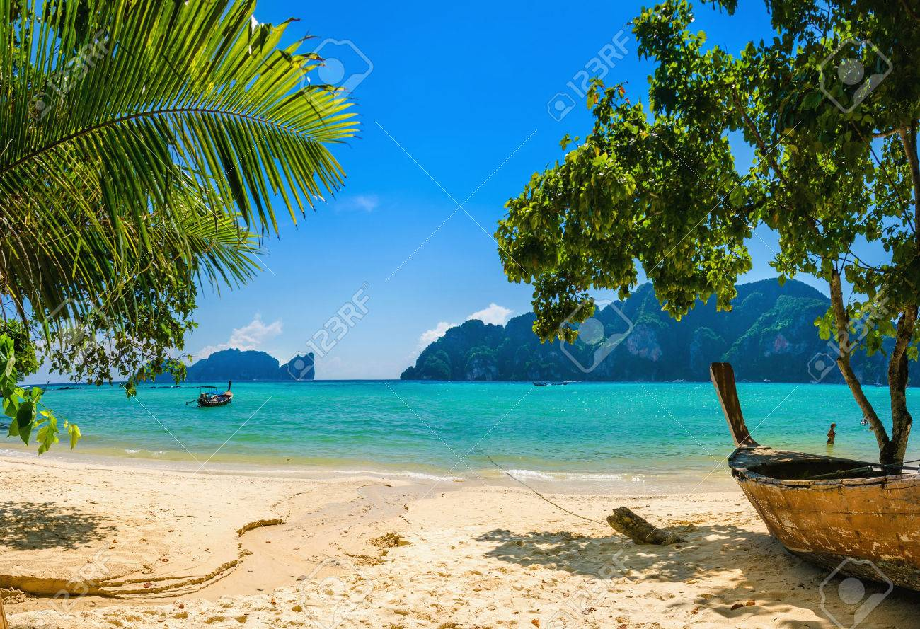 Exotic beach with palms and boats on azure water, Phi Phi Island, Phuket area, Thailand Stock Photo - 40513475