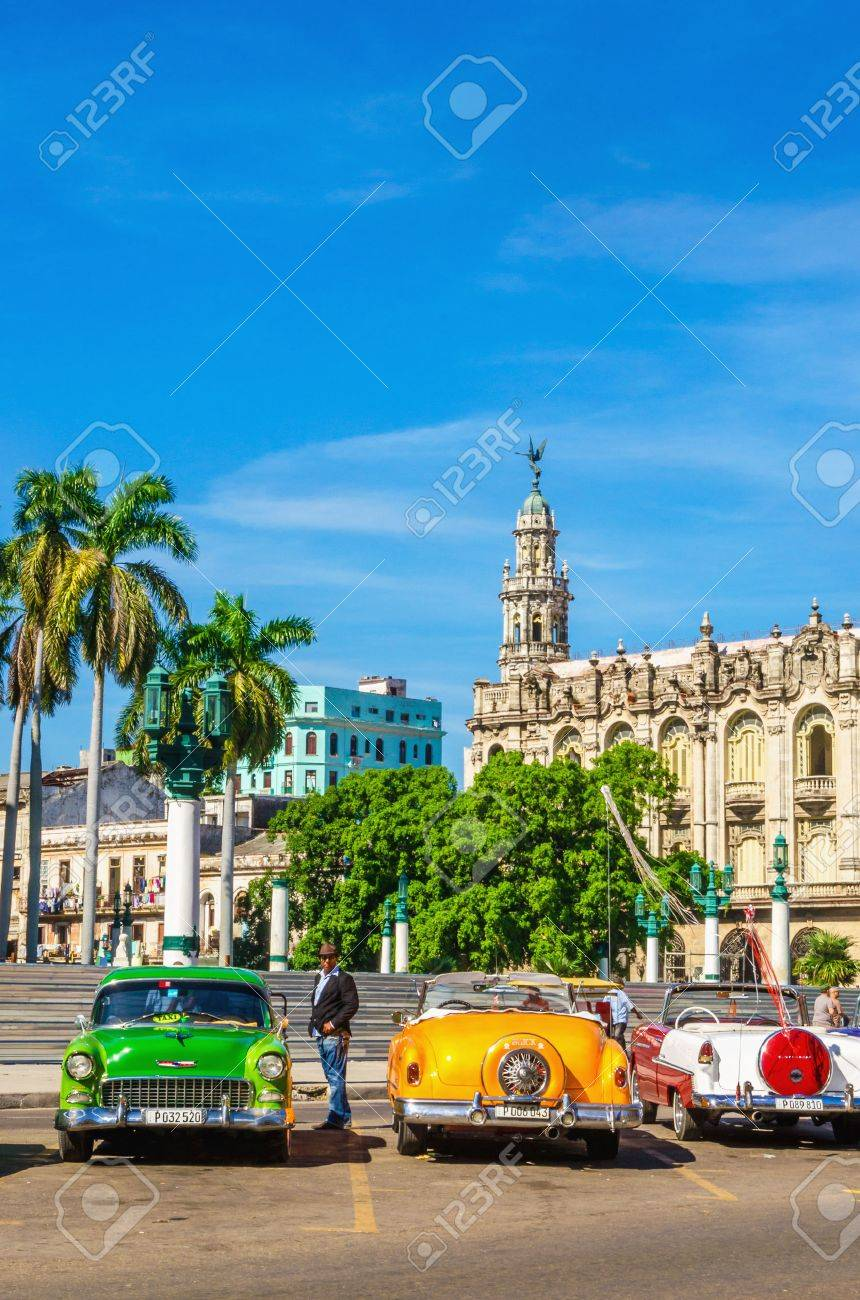 HAVANA, CUBA - DECEMBER 2, 2013: Classic American colorful cars one of streets in Havana, where old cars bought before Cuban revolution are icon view of Cuba Stock Photo - 40598048