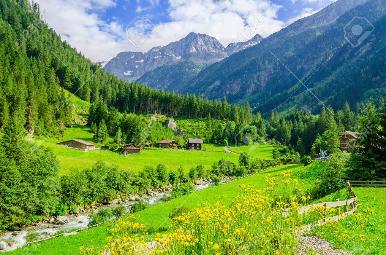 Beautiful alpine landscape with green meadows, alpine cottages and mountain peaks, Zillertal Alps, Austria Stock Photo - 40901936