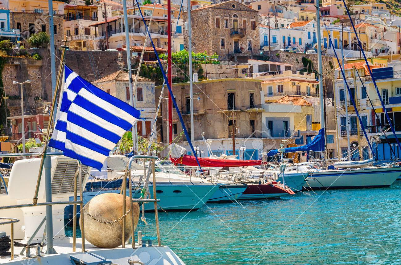 Blue white Greek flag and wind in Greek port full of boats, Kos, Greece Stock Photo - 44564030