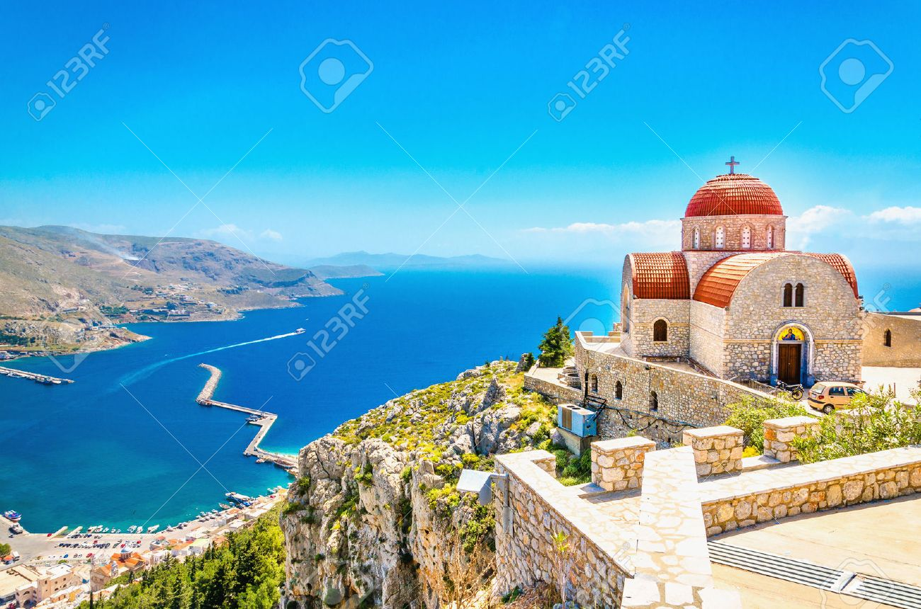 Amazing view on remote church with red roofing on the Cliff of the sea, Greece Stock Photo - 45059719