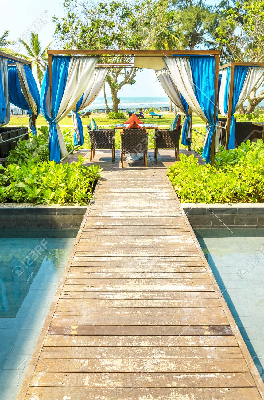 Beautiful luxury resort with an amazing sunbathing place in the garden of the hotel, sun loungers on small islands in the swimming pool,Sri Lanka, Asia Stock Photo - 47963020