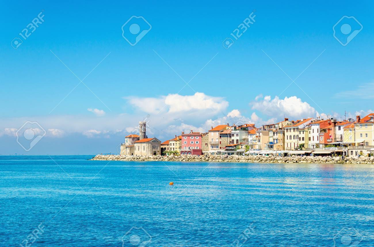 Rocky promontory with a small lighthouse, Piran, Slovakia, Europe Stock Photo - 87392485