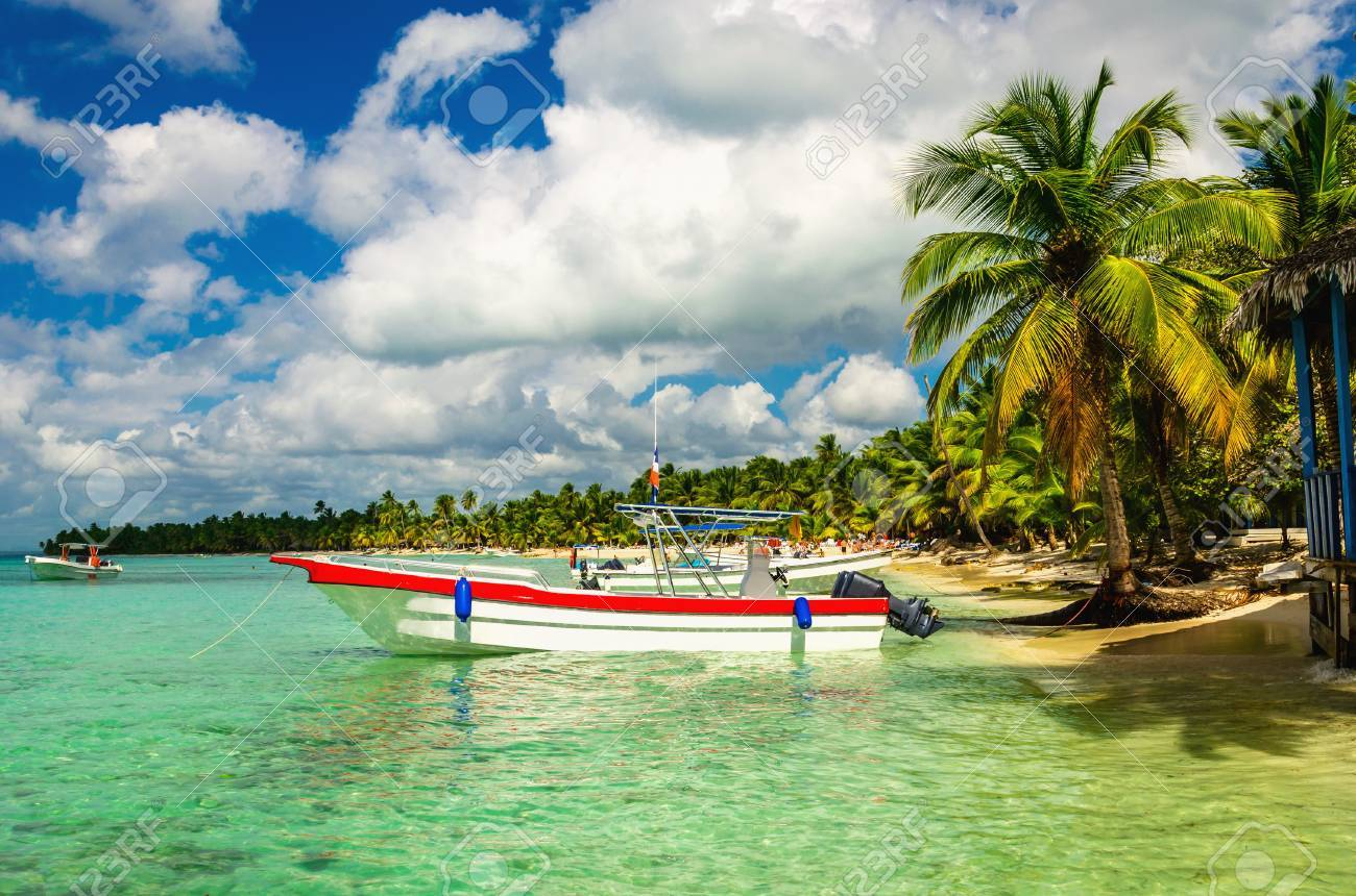 White and red boat on shore of Caribbean Islands, Dominican Republic Stock Photo - 87252065
