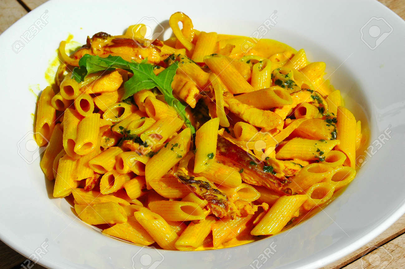Delicious Indian Curry Pasta With Chicken And Penne Noodles Served