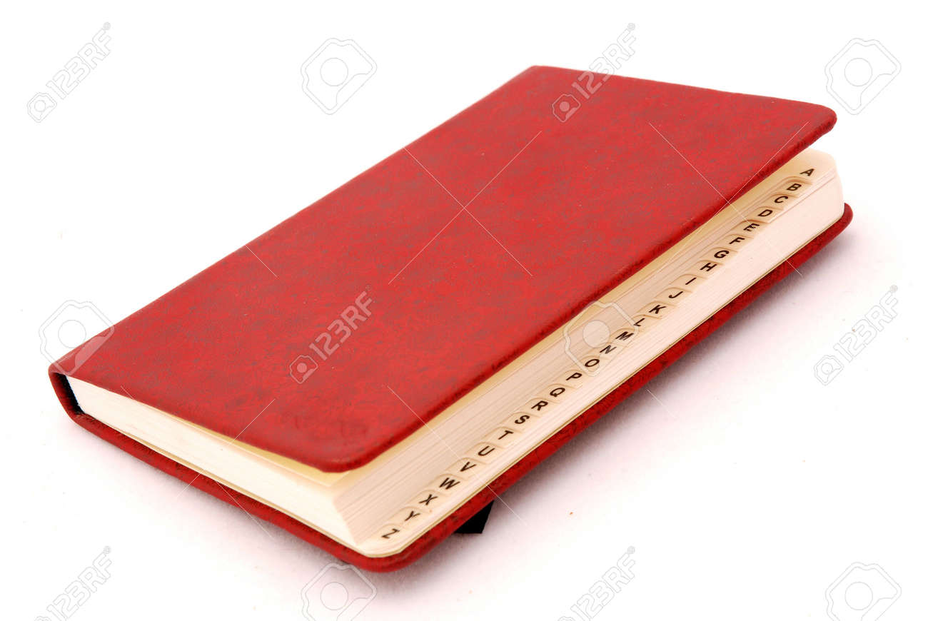 A red directory book with capital letters isolated on white background Stock Photo - 3352376