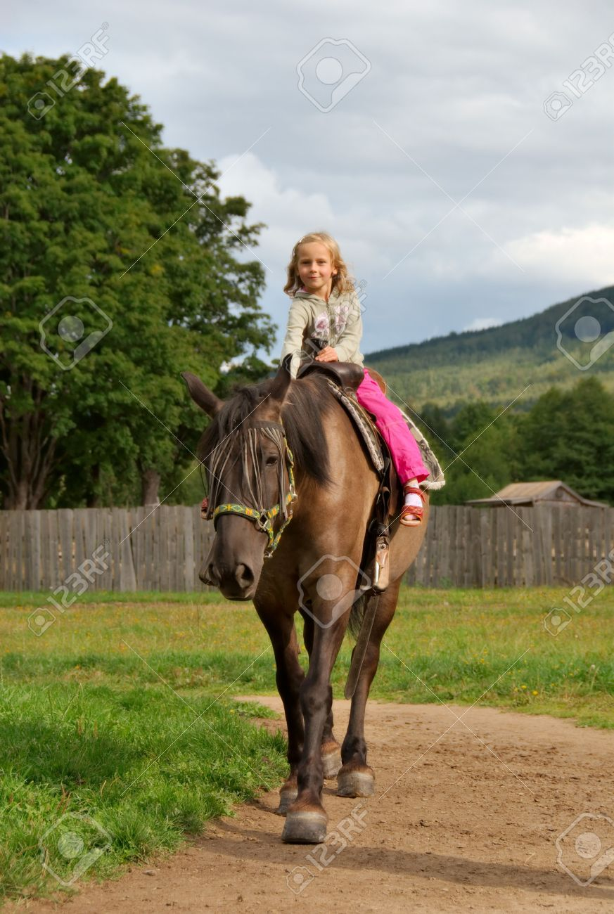 little girl on the horse Stock Photo - 4979039
