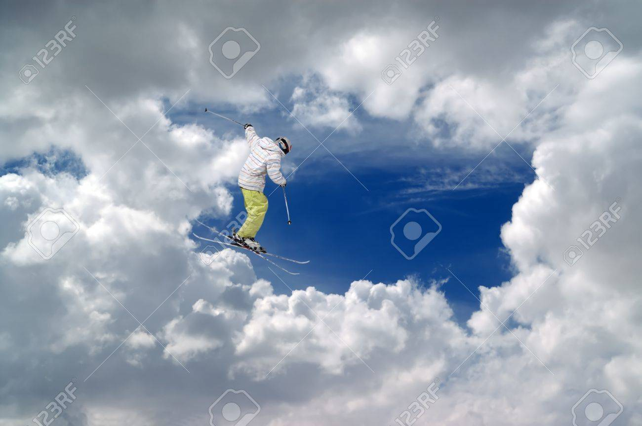 Freestyle ski jumper against blue sky with clouds Stock Photo - 11413268