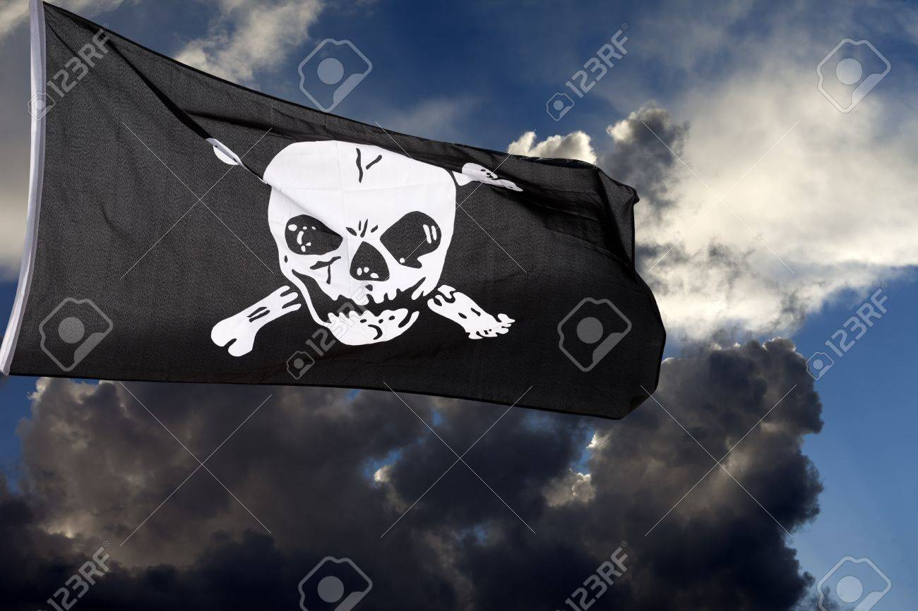 Jolly Roger (pirate flag) against storm clouds Stock Photo - 11893403